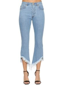 blue jeans with cropped ripped hemline
