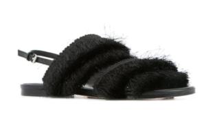 black sandals with black fringe detail